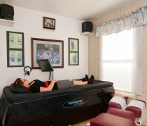 Patient laying down on a water therapy bed